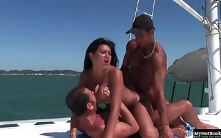 Tanned people are having steamy group sex on a yacht, in the middle be useful to the day