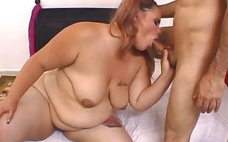 Heavy slut works the thick dong in both pussy and mouth