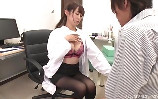 Amateur movie of a horny Japanese nurse giving a blowjob. HD