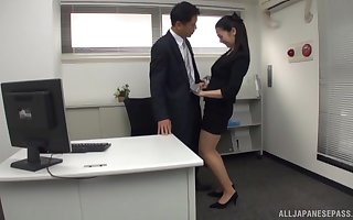 Pretty Asian secretary drops above her knees to pleasure his dick