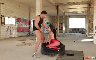 Outcast brunette in red underclothes is ready to ride cock in abandoned place