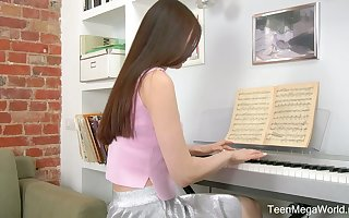Demure teen Melissa is effectuation put emphasize piano increased by masturbating will not hear of pussy