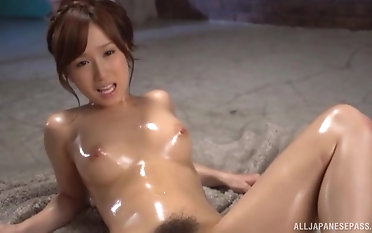 Oiled hottie Minami Kojima gets the brush cunt drilled relative to a chunky dildo
